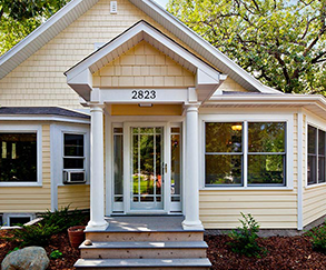 Front-entry porch and heated-entry porch were added to this turn-of-the-century classic.